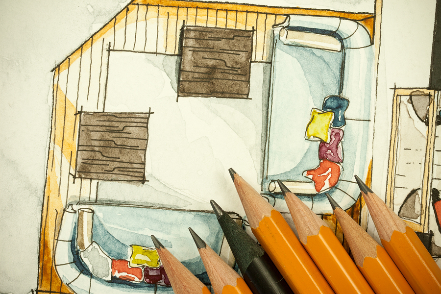 Pencils on top of a watercolour sketch of a furnished deck