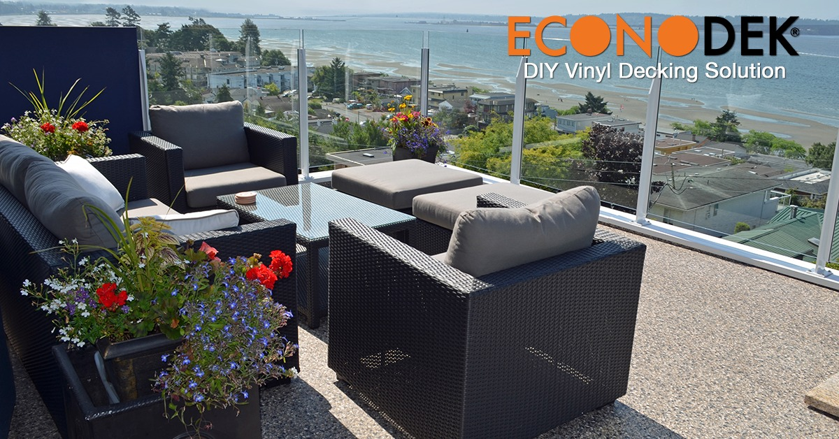 Econodek waterproof vinyl deck with outdoor furniture overlooking a lake